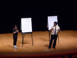 Dr. Benjamin and his daughter on stage during the Mathemagics show this week at Fermilab.