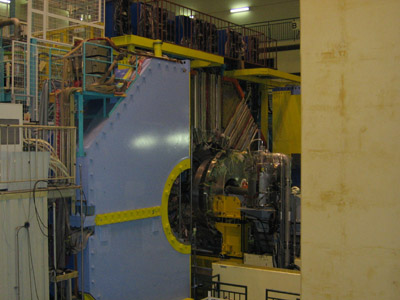 A view of the Belle detector, opened for maintenance. The big blue piece is part of the magnetic flux return for the detector, the real high tech is deeper in, closer to the beam pipe.
