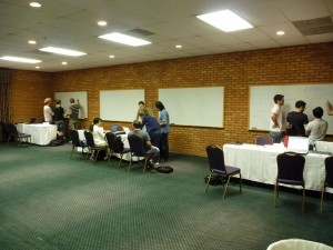 Three of the student groups getting started discussing their chosen questions.