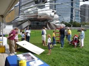 The Fermilab tent at the Millennium Park LabFest with the Pritzker Pavillion in the backgroud.