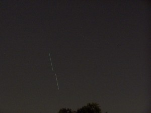 Discovery and ISS rising.