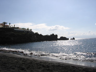 What would a summer vacation be without a beach? The black sand is a design mistake, though, at least for the feet...