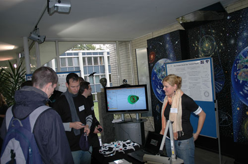 Members of my group at the open day in the morning, with the 3D event display getting ready for action.