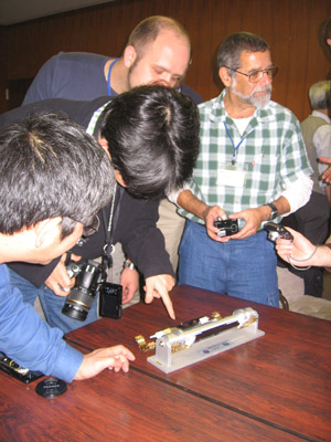 Belle-II members crowding around the model of the PXD.