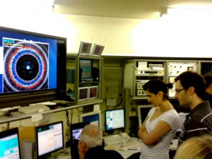 Members from the Munich team, including my grad student Andreas, looking at first events of our background run in the BELLE control room.