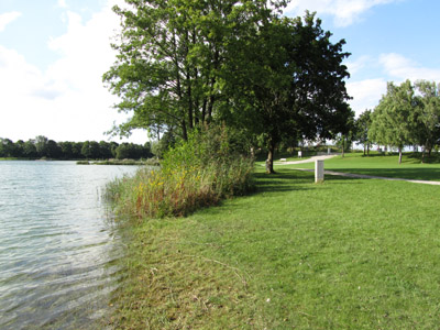 Empty lake north of Munich: At a weekend at the end of August, no grass should be visible for all the people lying in the sun... But it feels like fall, not like summer with temperatures just a bit over 10 deg. C.