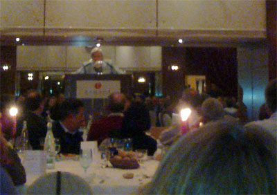 "The CERN DG, consulting a ""crystal ball"" during the conference dinner."
