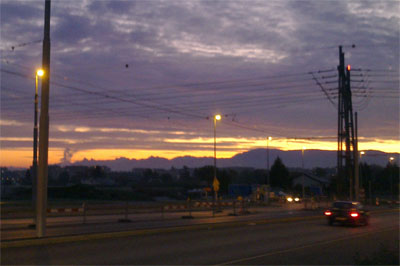 Early morning start on the parking lot outside of CERN: Sunrise, and a fantastic alpine panorama.