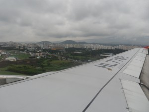An airplane wing over Jeju, Korea
