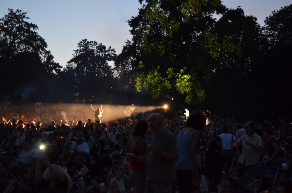 A reveller caught in the spotlight at the outdoor film.