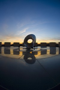 You can also watch the sun set from the Sunset conference room. Here, it sets over Mobius Strip, a sculpture outside Wilson Hall. Photo: Reidar Hahn