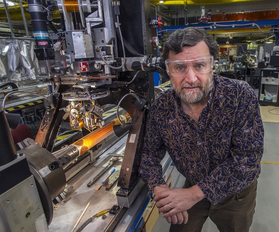 Brookhaven Lab accelerator physicist Stephen Peggs with magnet technology that could reduce the size of particle accelerators needed to steer heavy ion beams and deliver cell-killing energy to precisely targeted tumors while sparing surrounding healthy tissue.