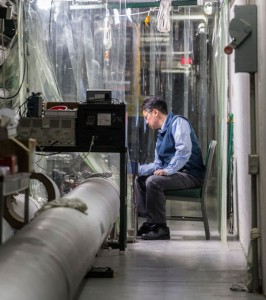 Aaron Chou, project manager for Fermilab's Holometer, tests the experiment's instrumentation. Photo: Reidar Hahn