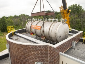 The 30-ton MicroBooNE neutrino detector is gently lowered into the Liquid-Argon Test Facility at Fermilab on Monday, June 23. The detector will become the centerpiece of the MicroBooNE experiment, which will study ghostly particles called neutrinos. Photo: Fermilab