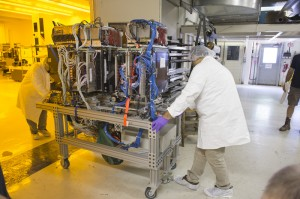 Members of the prototype proton CT scanner collaboration move the detector into the CDH Proton Center in Warrenville. Photo: Reidar Hahn