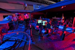 A Fermilab scientist works on the laser beams at the heart of the Holometer experiment. The Holometer will use twin laser interferometers to test whether the universe is a 2-D hologram. Photo: Fermilab