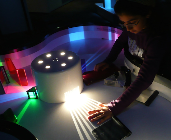 Real scientists don't merely observe, they don't merely interact, they create.  (Child at the Science Museum London, studying an optical exhibit.  Nevit Dilmen 2008)