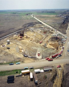 This aerial view shows the Neutrino Area under construction in May 1971. The 15-foot bubble chamber, pictured on the left, would later be moved to the present-day location of Lab D.  Photo: Fermilab