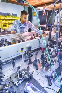 Harsha Panunganti of Northern Illinois University works on the laser system (turned off here) normally used to create electron beams from a photocathode. Photo: Reidar Hahn