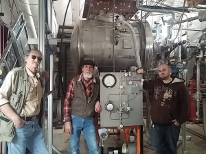 Technicians John Cornele, Pat Healey and Skyler Sherwin have been crucial in preparing the LArIAT detector for beam. The liquid-argon-filled detector saw first beam on Thursday. Photo: Jen Raaf