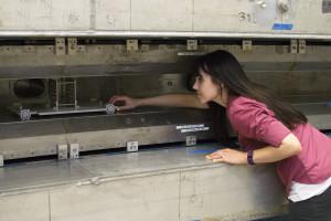 Kerbie Reader, a high school math teacher, works at the Muon g-2 ring as part of Fermilab's TRAC program. Photo: Ali Sundermier